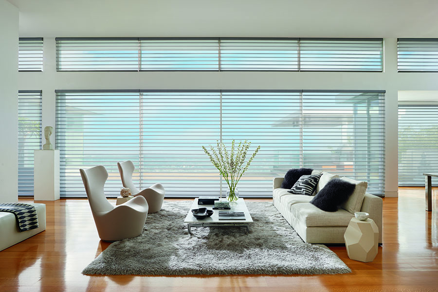 floor to ceiling windows covered with view through sheer shades in Fort Myers FL