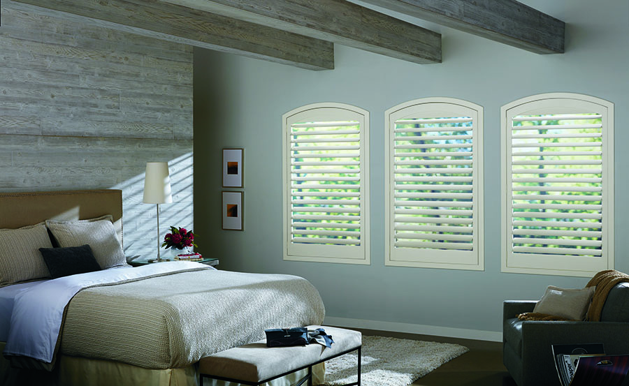 plantation shutters on arched windows in bedroom Fort Myers FL