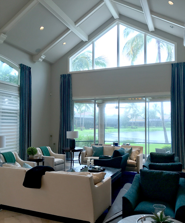 stationary drapery panels on large windows in Fort Myers FL living room