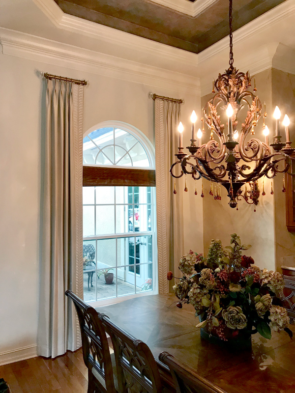 arched window design with side drapery panels Fort Myers FL