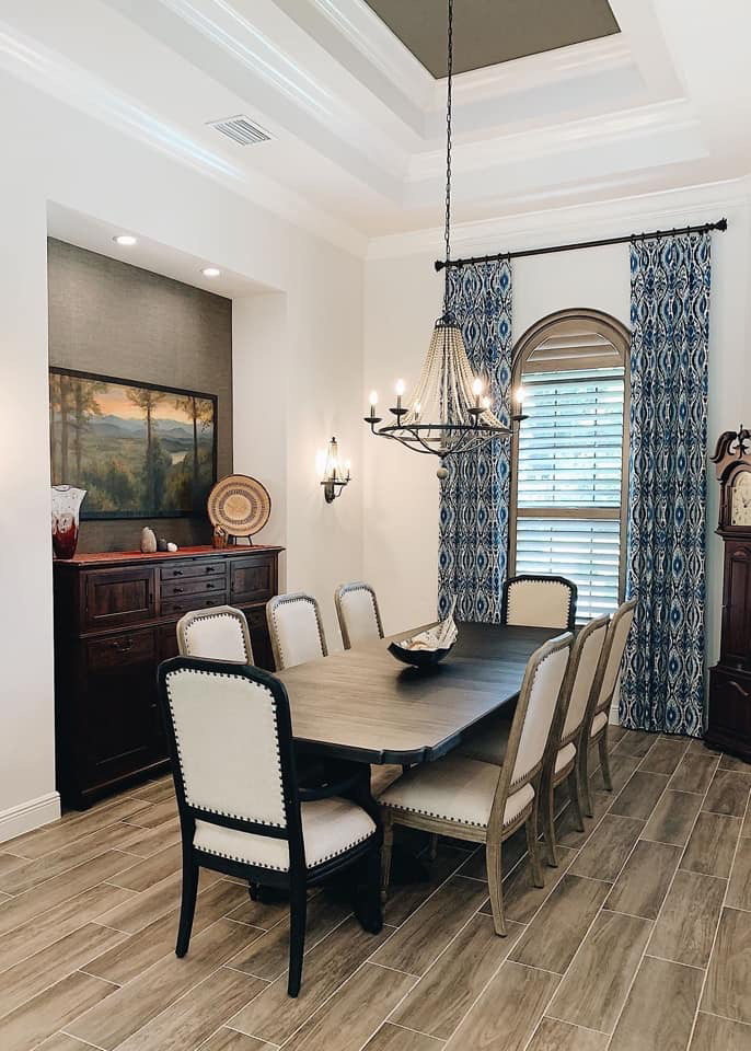 arched shutters in dining room with drapery side panels Fort Myers FL
