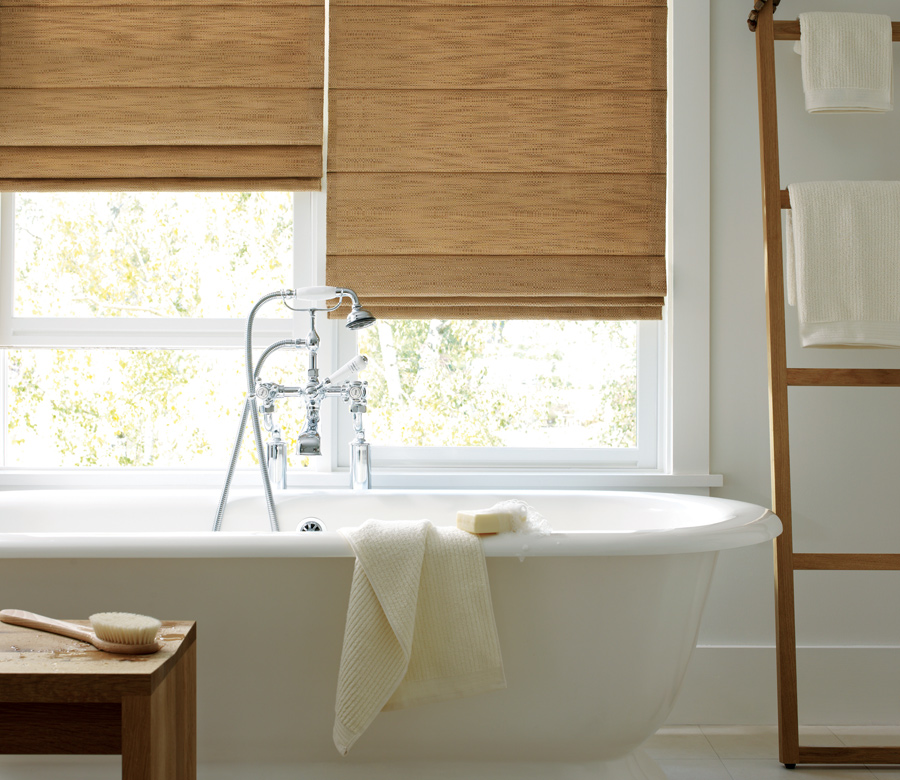 bathroom with woven studio roman shades by hunter douglas fort myers