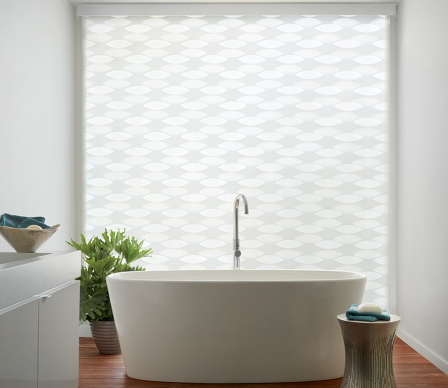 master bathroom with stand alone tub and white banded roller shades hunter douglas 34103