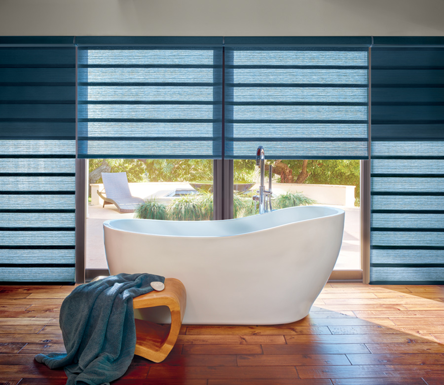 bathroom with standalone tub and blue hunter douglas roman shades Fort Myers