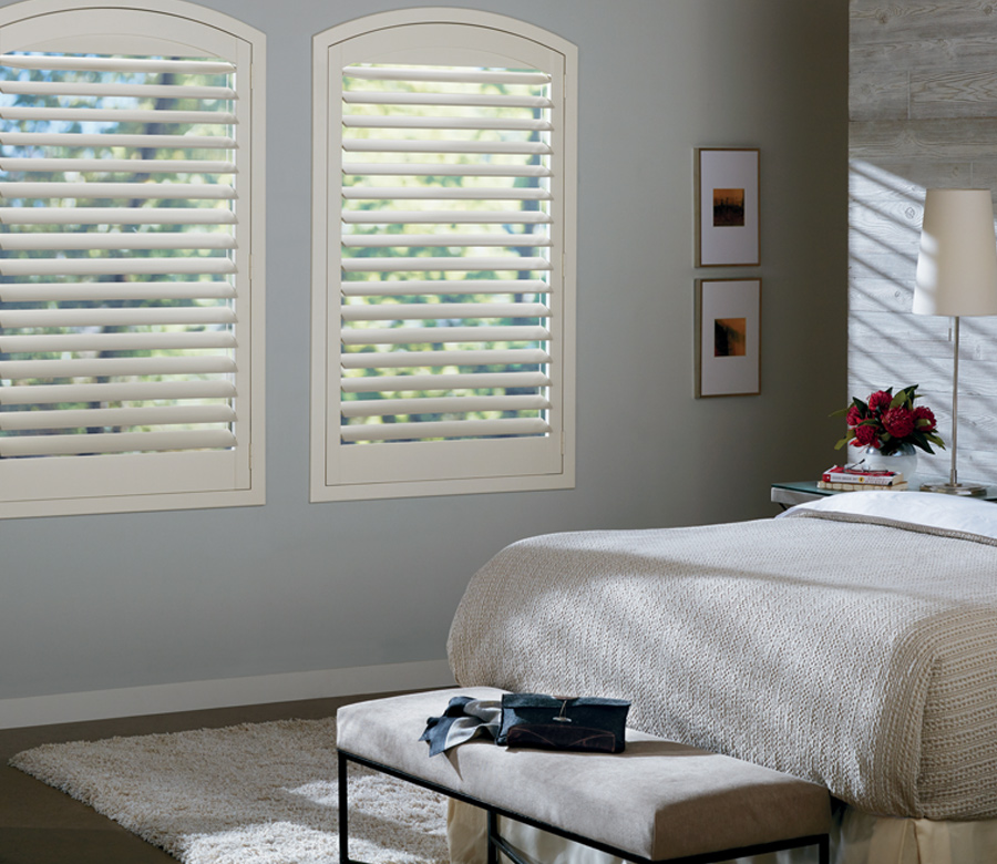white newstyle plantation shutters in light blue bedroom Hunter Douglas 34109