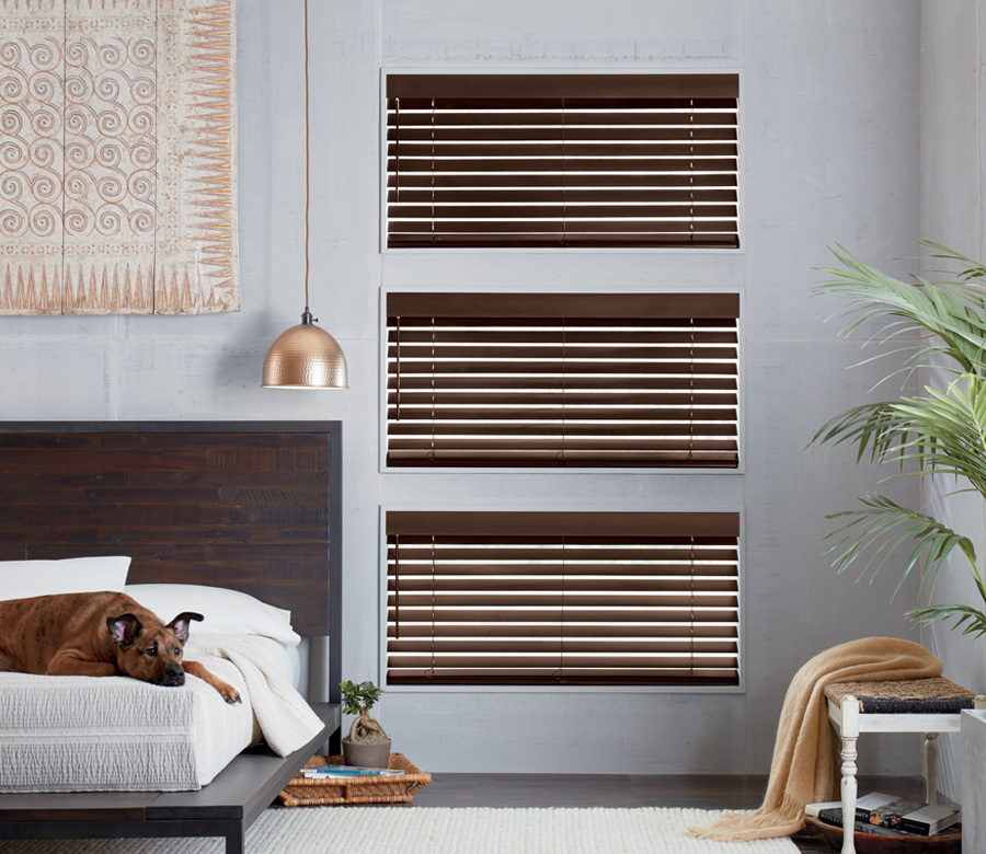 rustic bedroom with dog and hunter douglas brown wood blinds Naples