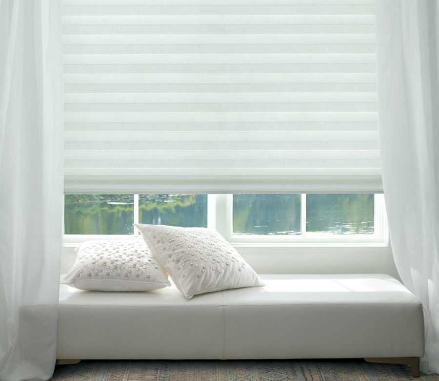 window seat with white solera fabric roman shades hunter douglas Naples 34108