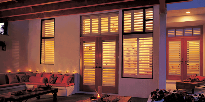 exterior view of fort myers home with hunter douglas shutters interior windows