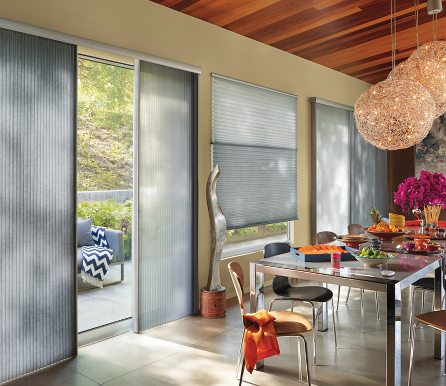 modern living room with pink lamps and duette vertiglide shades 34145
