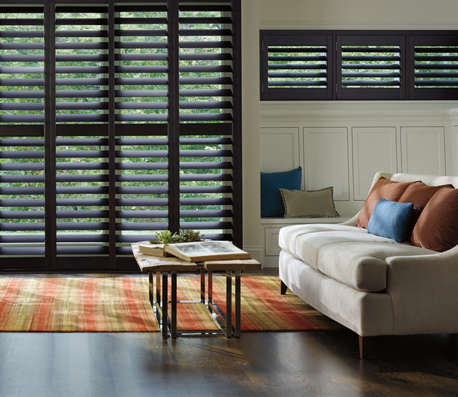 traditional living room with black hardwood shutters on large windows Hunter Douglas Fort Myers