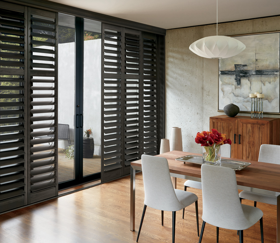 modern living room black newstyle plantation shutters on sliding glass doors hunter douglas naples