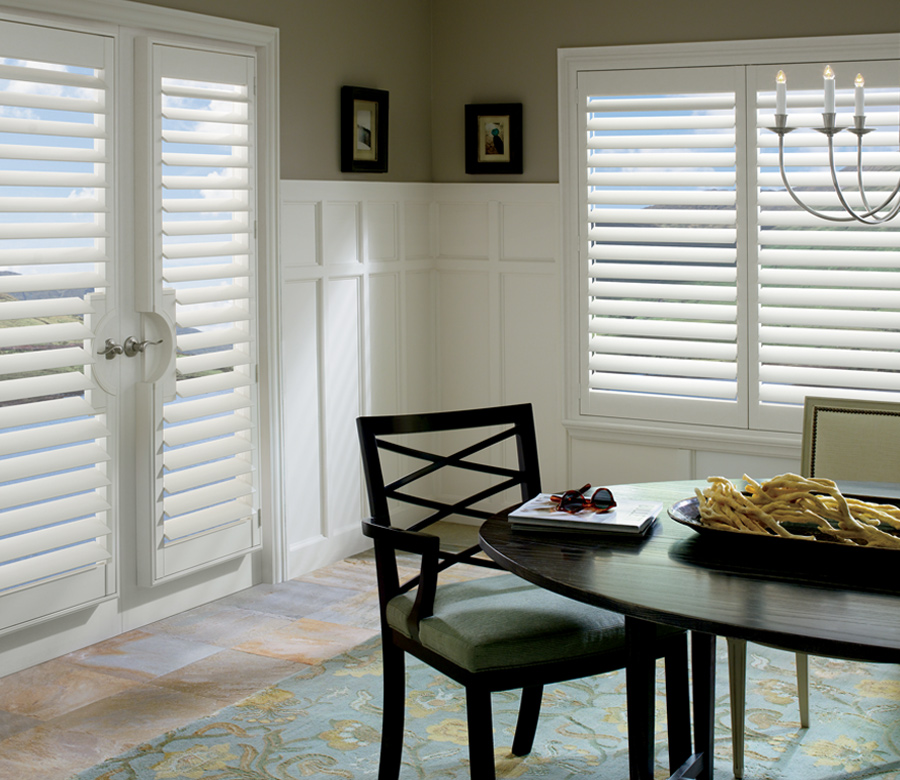 dining room with palm beach polysatin plantation shutters on french doors hunter douglas 34109