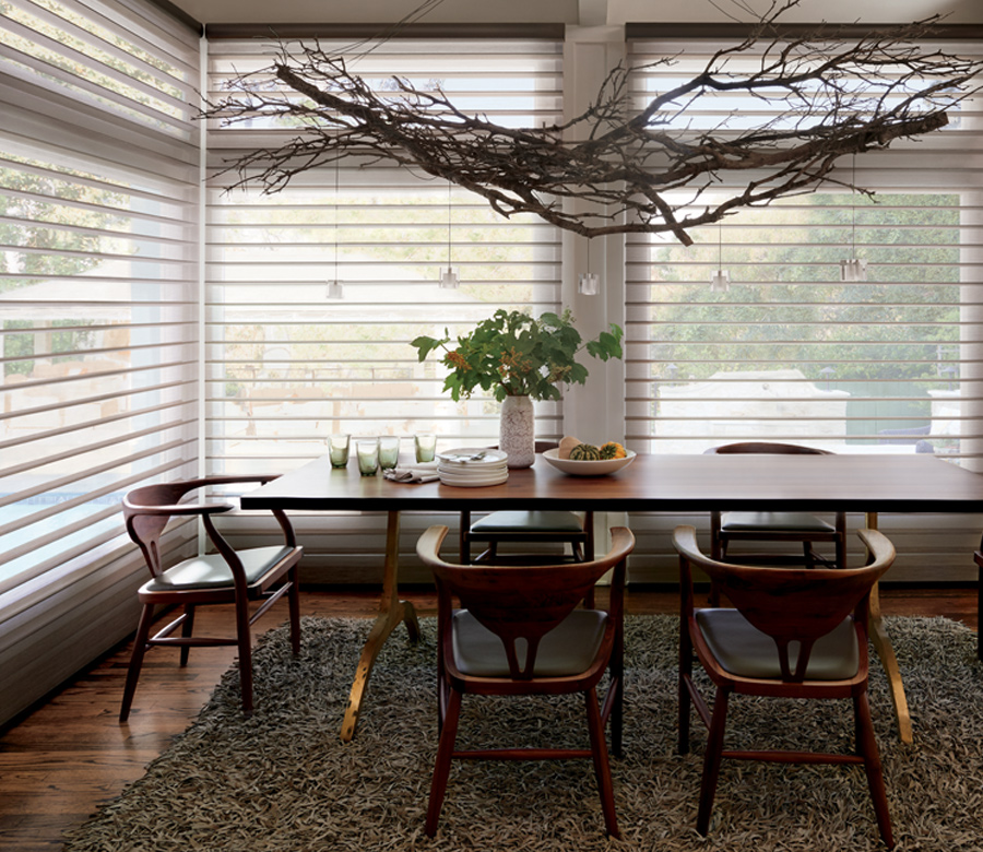 dining room with hunter douglas silhouette shades on large windows Fort Myers