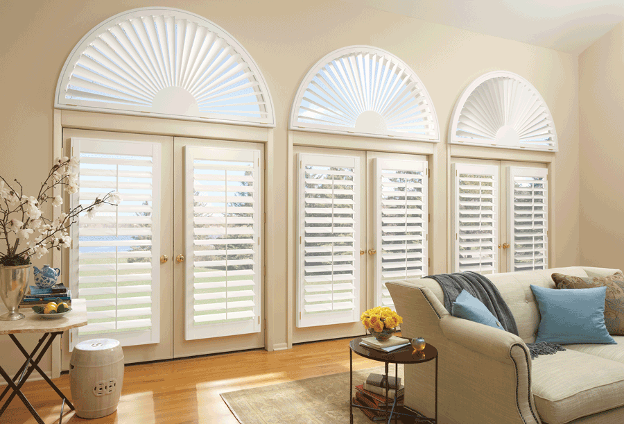 living room french door plantation shutters arched window treatments Hunter Douglas Fort Myers 33908