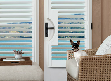 Hunter Douglas plantation shutters PalmBeach Motorized shutters on french doors Naples Fl