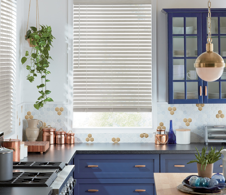 kitchen with navy blue detail and hunter douglas everwood blind Naples