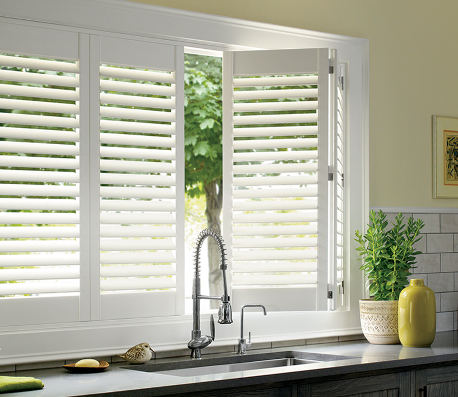 traditional kitchen with white palm beach shutters by Hunter Douglas Fort Myers