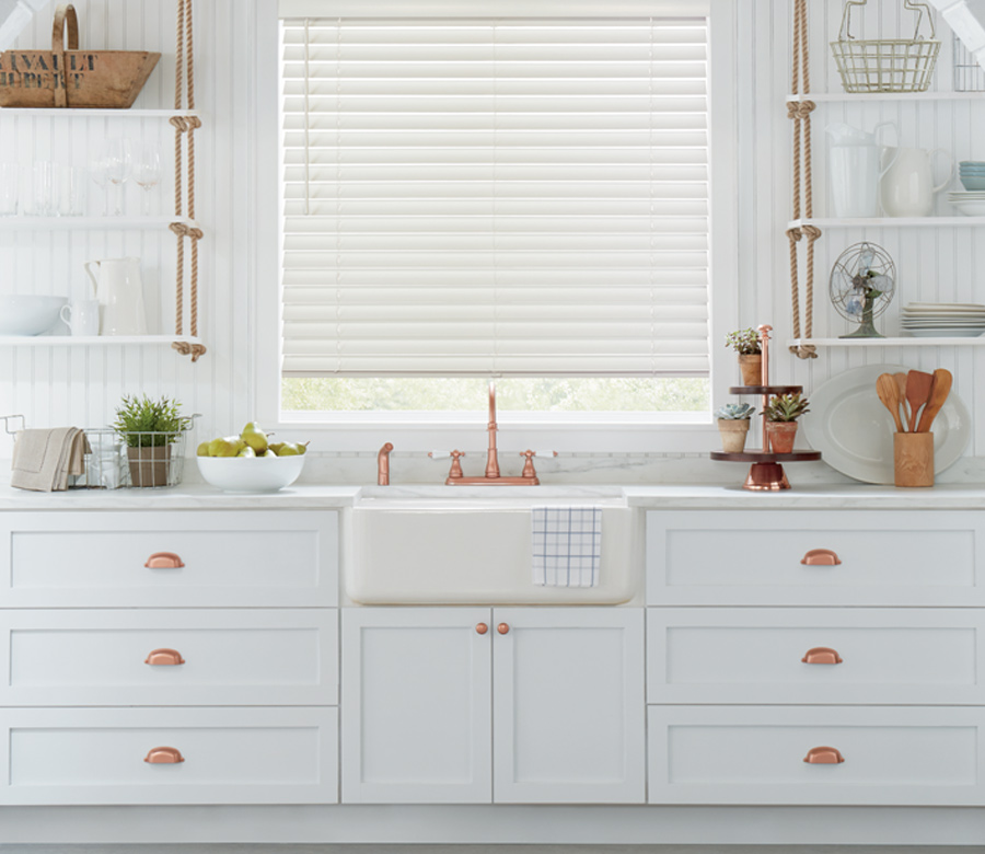 urban kitchen with copper details and hunter douglas white wood blinds 34103