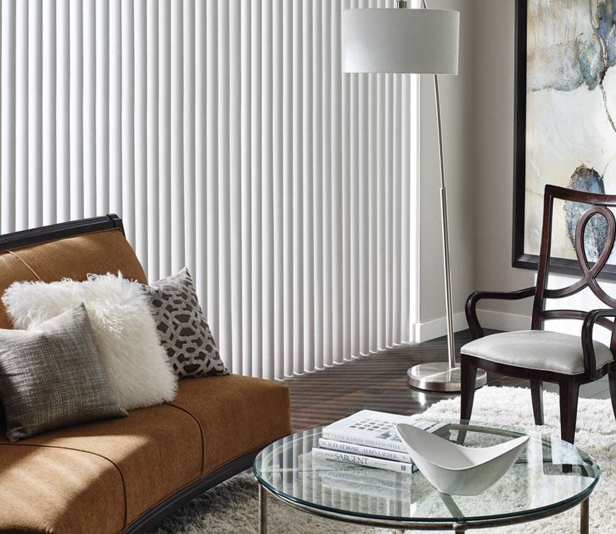 living room with hunter douglas cadence fabric vertical blinds Fort Myers