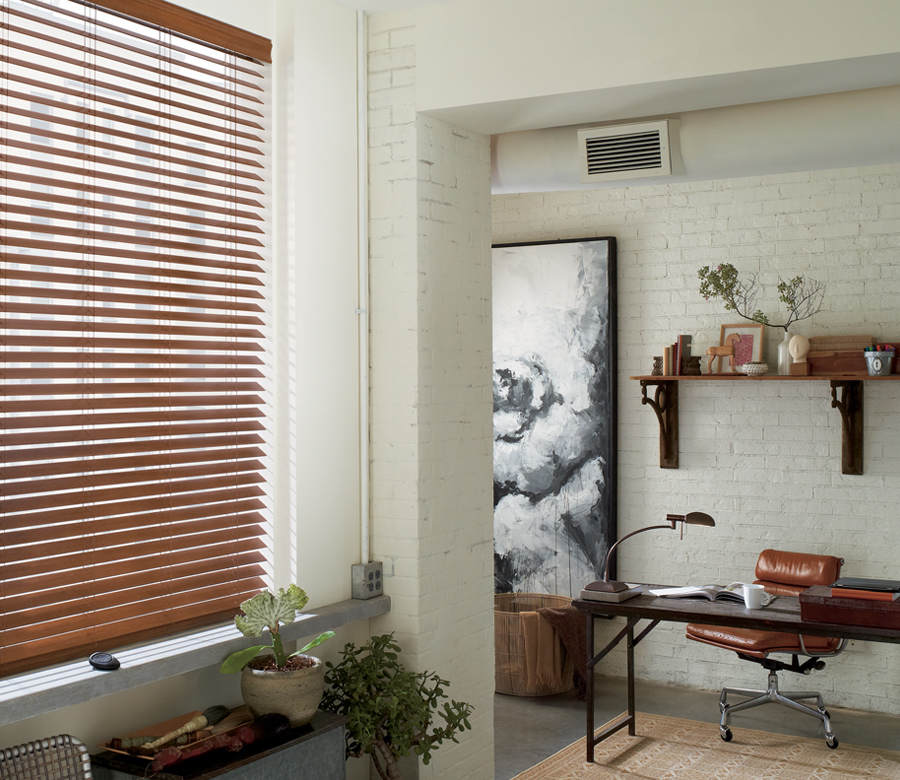 urban home office with dark faux wood blinds Hunter Douglas 34103