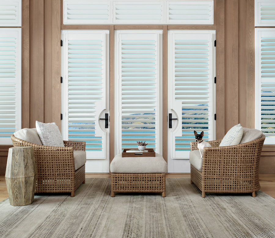 two woven chairs with hunter douglas palm beach plantation shutters 34108