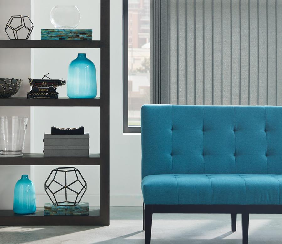 living room with blue sofa and hunter douglas somner soft vertical blinds Naples 34110