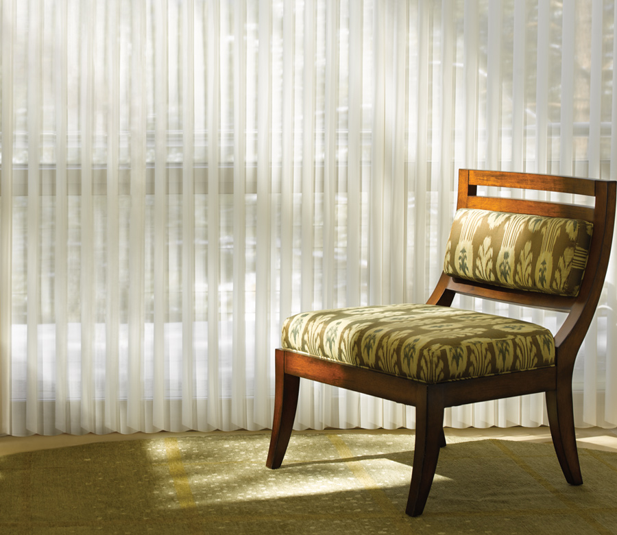 green chair with hunter douglas vertical sheer shades Fort Myers 33908