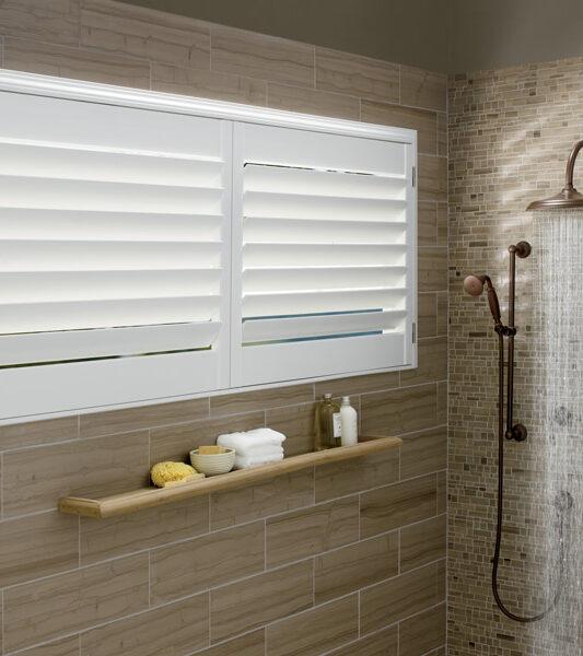 bathroom motorized shutters hunter douglas polysatin shutters Naples Fl,