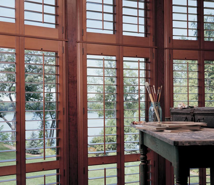 home office with hunter douglas dark wood heritance hardwood shutters 34120
