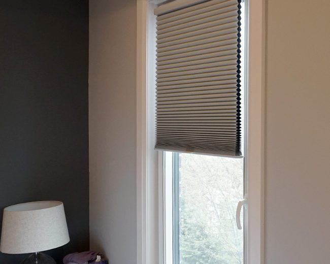 bedroom with hunter douglas duette honeycomb shades with track glide system Fort Myers