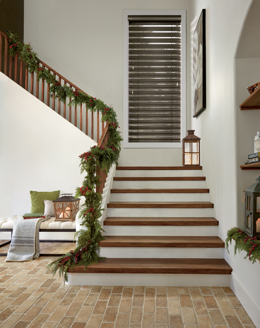 beautifully decorated holiday entryway with Hunter Douglas blinds Naples 34119