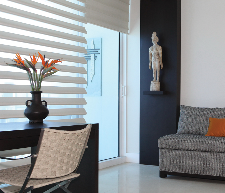 contrast in living room design with white Hunter Douglas pirouette shades Fort Myers 33908