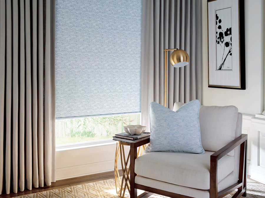 gold lamp in cozy corner with drapery panels fabric roller shades fort myers fl