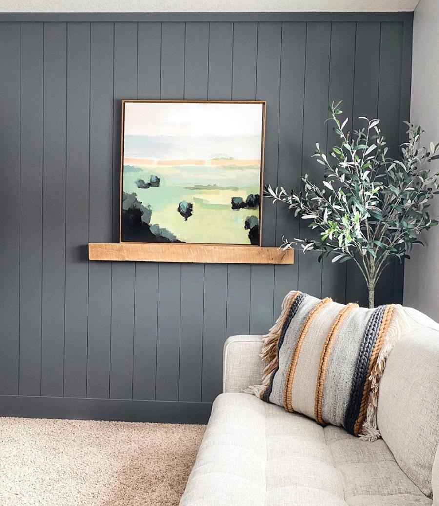 Dark painted vertical shiplap in living room.