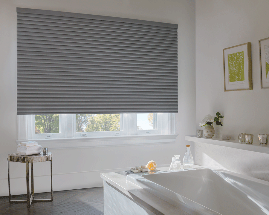 Looking for a way to get rid of light when it's not needed? Try room darkening shades.