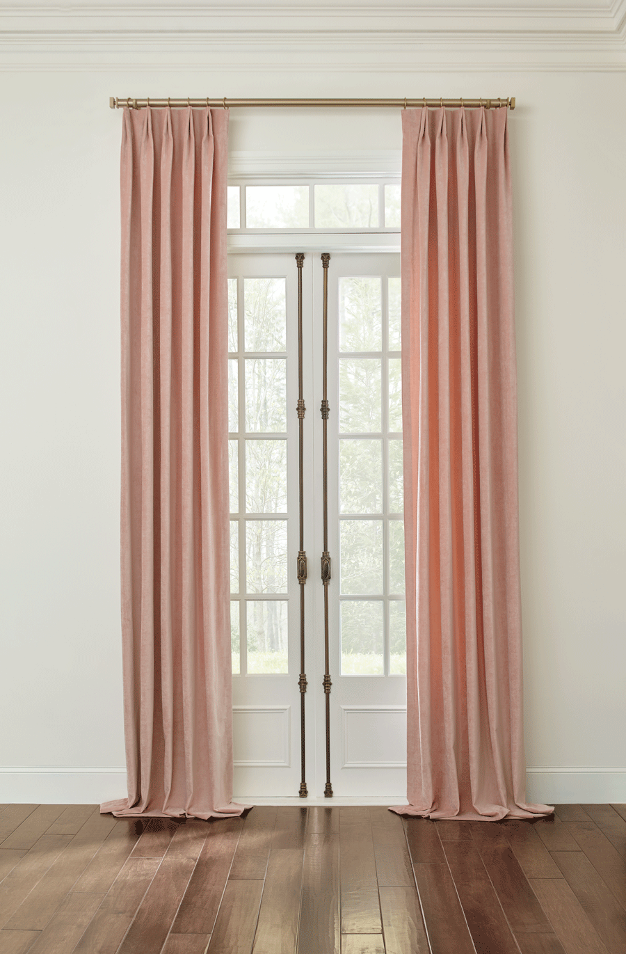 drapes on french doors with gold hardware that puddle on the floor