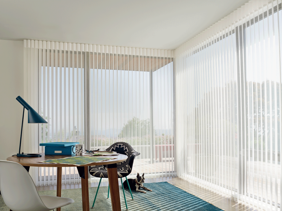 Sheer window treatments to reduce glare in your home office.