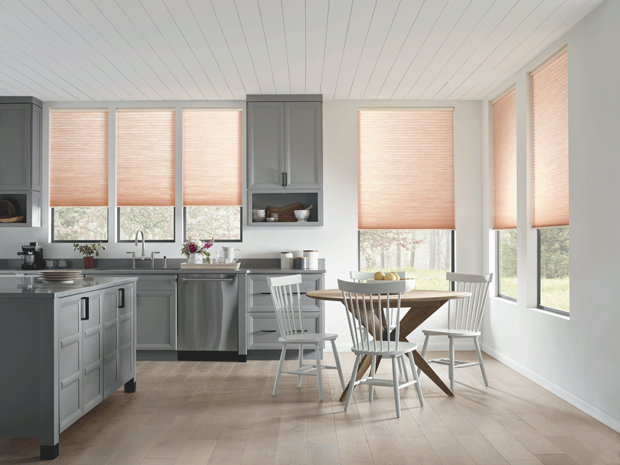 Kitchen transformation with window treatments to block harsh light.