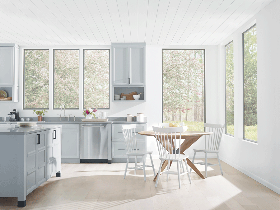 Kitchen with no window treatments is drowning in light.
