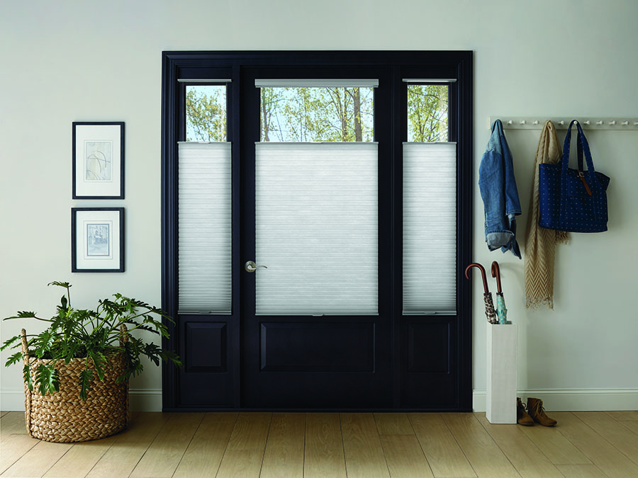 Entryway doors with Honeycomb shades for increased safety.