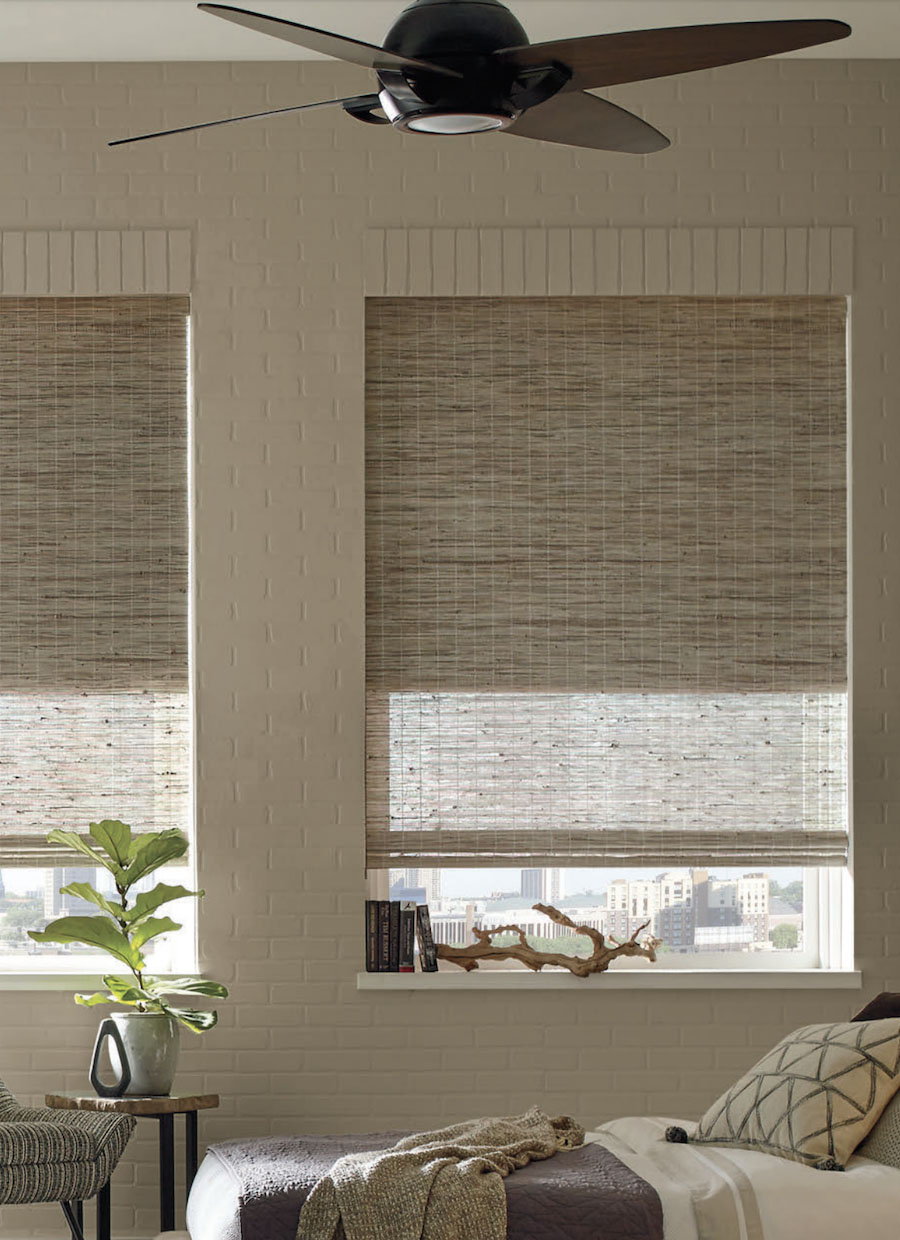 Hunter Douglas Provenance woven woods cellular dual shades in bedroom.
