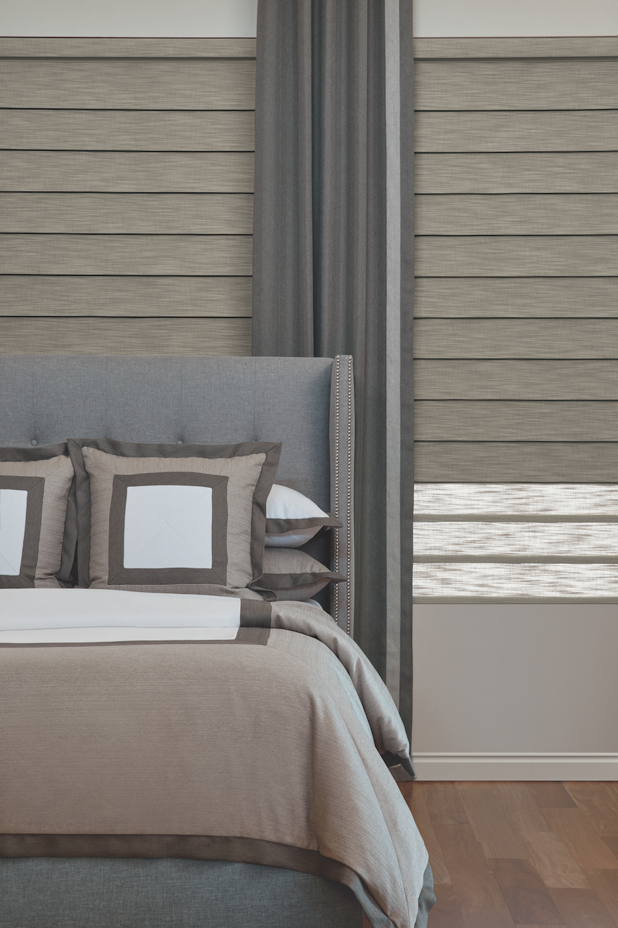 Master bedroom with vignette roman shades