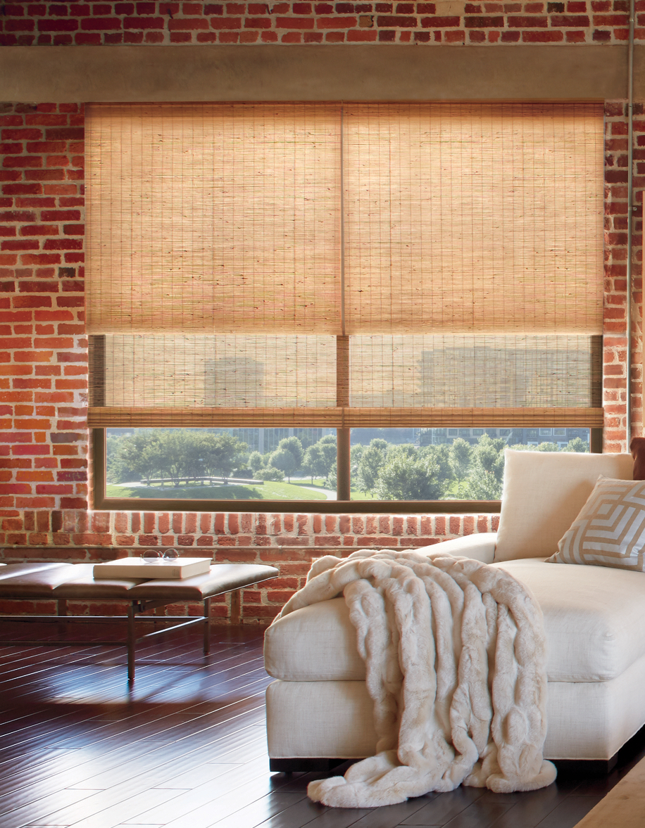 A loft with dual woven shades