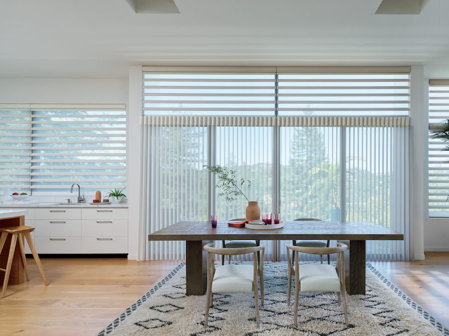 Vertical and horizontal window shades in dining room.