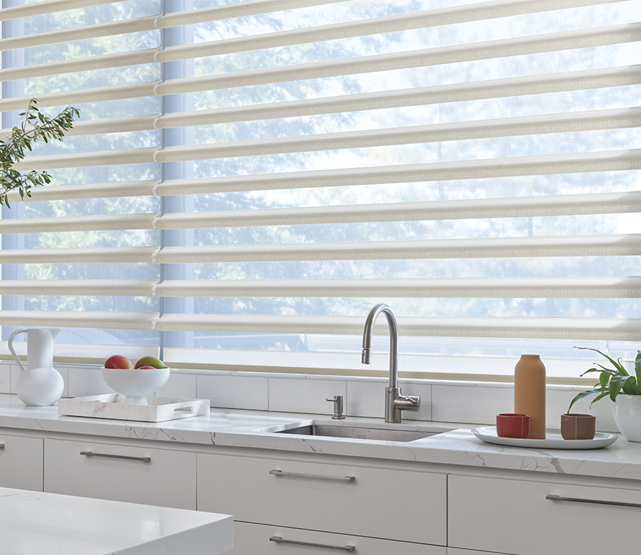 kitchen windows with white pirouette shades in Fort Myers FL