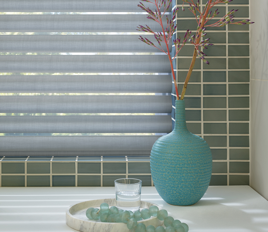 bathroom with green tile and gray window shades Naples FL