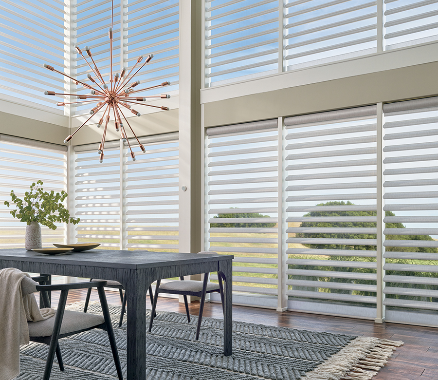 Floor to ceiling windows with light pirouette sheer shades Fort Myers FL