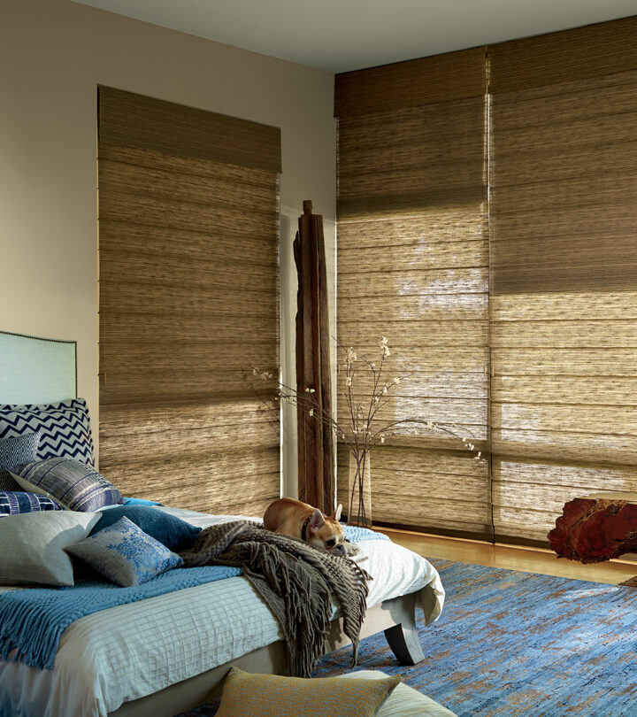 large windows in bedroom with woven wood shades in Fort Myers