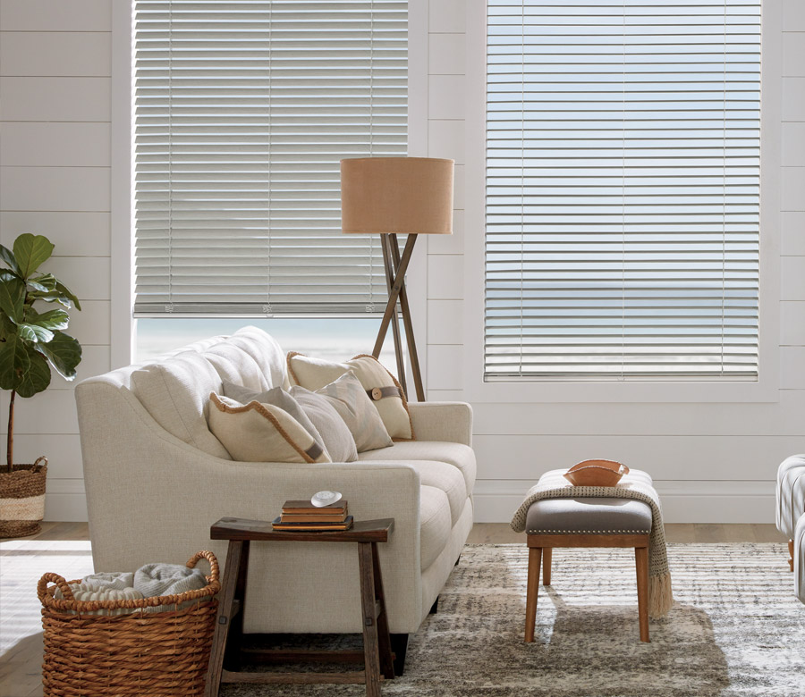 contemporary living room with neutral faux wood blinds in Naples FL