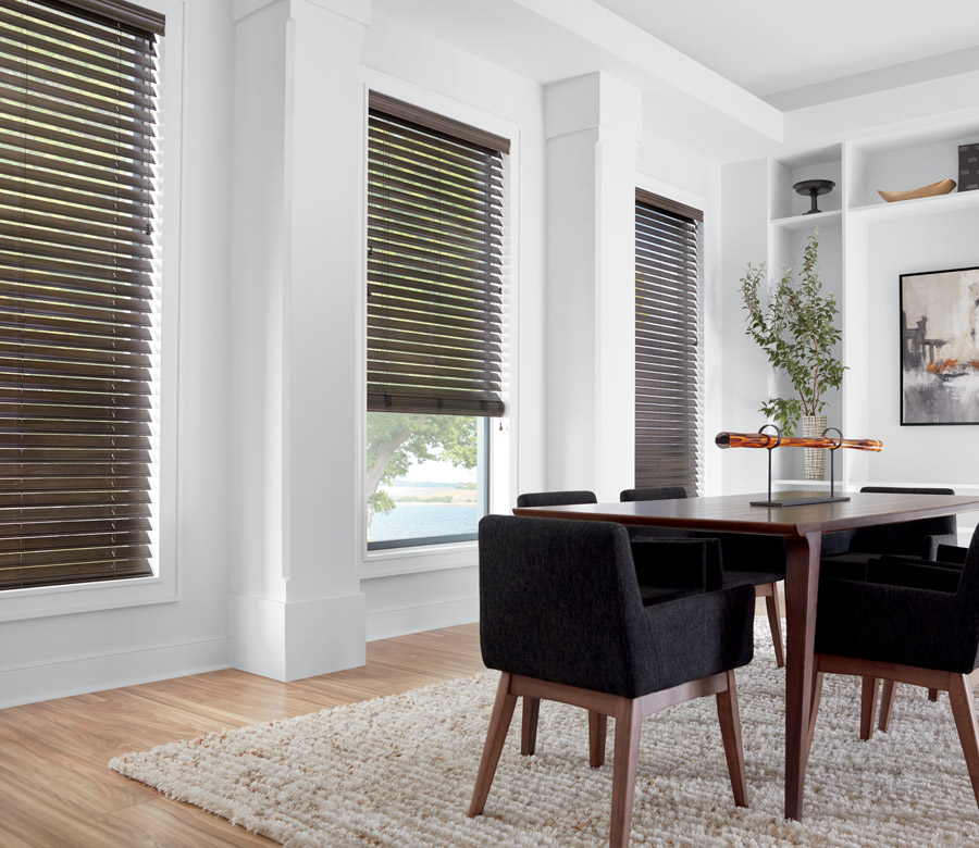 dining room in Fort Myers FL with dark faux wood blinds